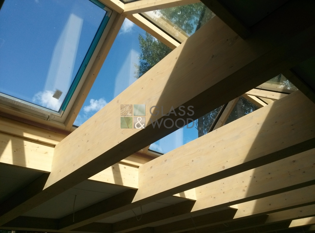 Glass and wooden roof constructions