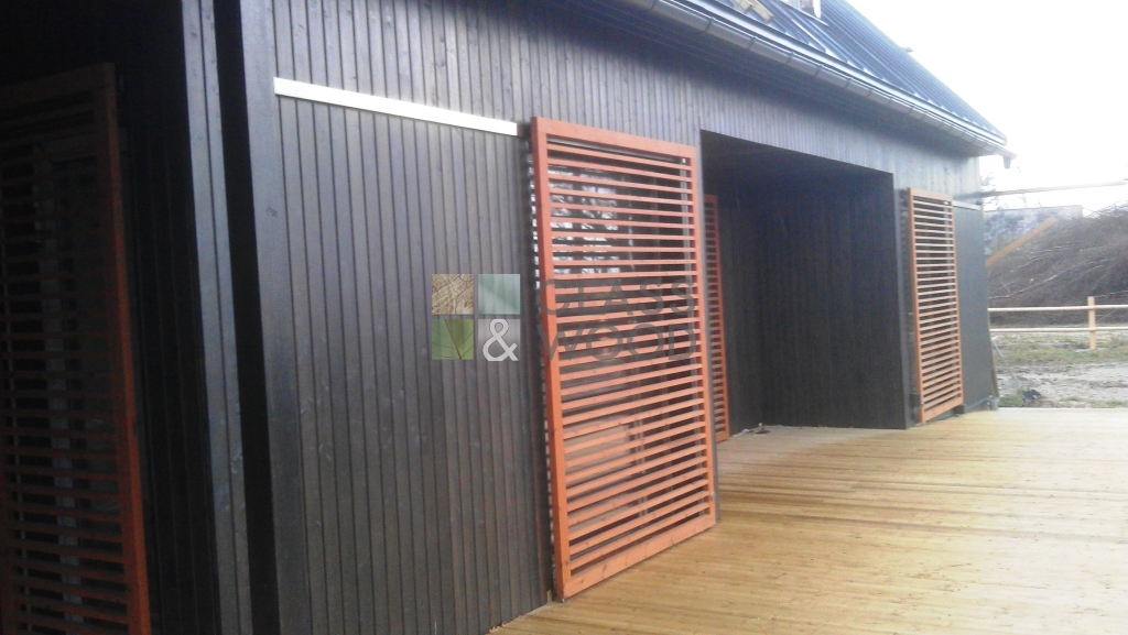 Wooden house with sliding shutters