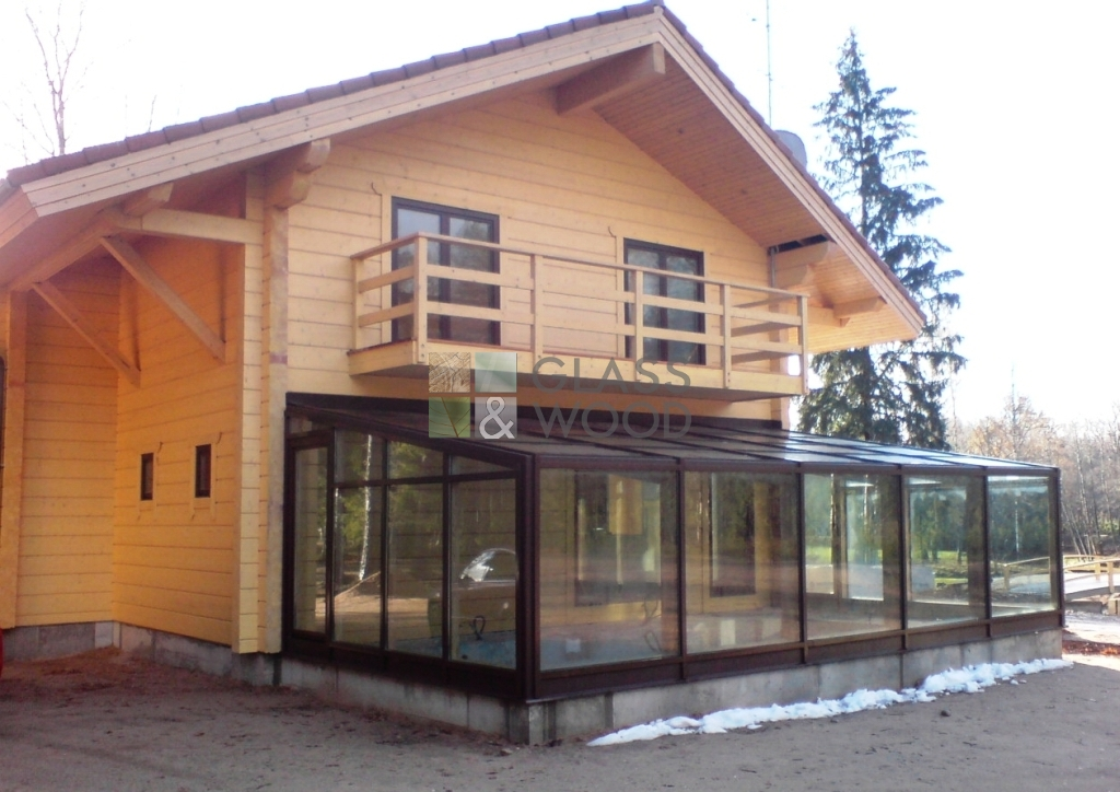 Wooden house with structural glazing outbuilding
